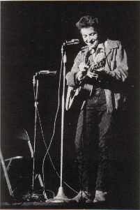 Bob Dylan performing at St. Lawrence University in New York. 26 November 1963