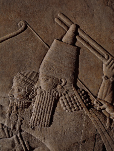 Detail of Assubanipal (reign: 668-627 BC) on a chariot during a lion hunt. Neo-Assyrian relief depicting a lion hunt (British Museum)
