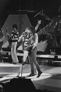 he Rolling Stones in concert at the Checkerdome in St. Louis, Missouri (USA) on November 19, 1981. Front: Mick Jagger (left) and Keith Richards (right); back: Bill Wyman; only partly visible: Ron Wood (far left) and Charlie Watts (far right, behind the drums)
