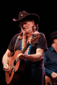 Singer-songwriter Willie Nelson, performing during the Country Throwdown Tour in 2011