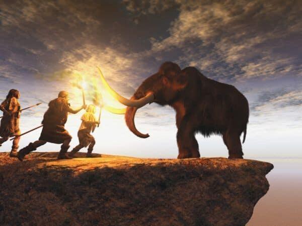 Prehistorische mannen jagen op een jonge mammoet